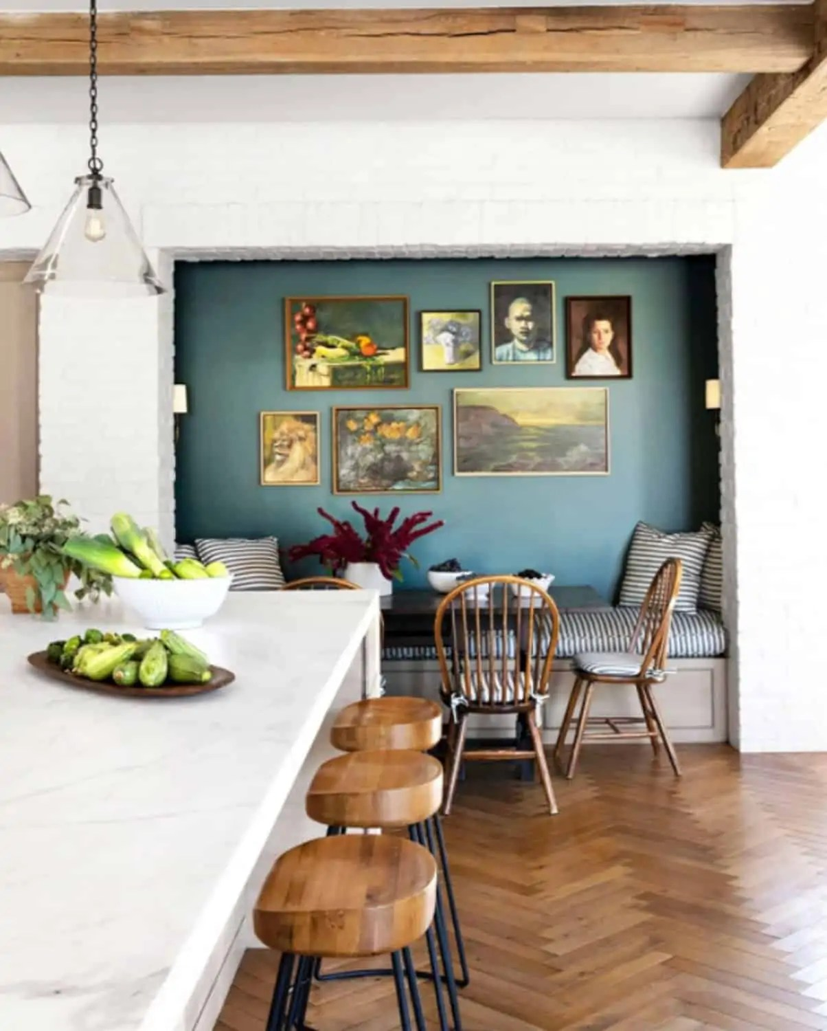 art gallery teal accent wall in kitchen