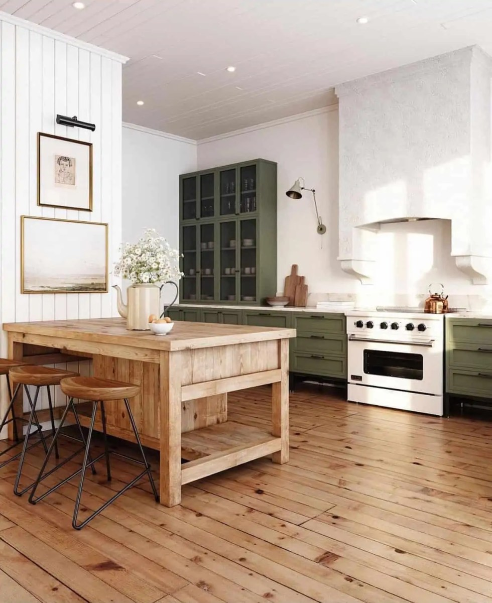 Natural wood island with green cabinets