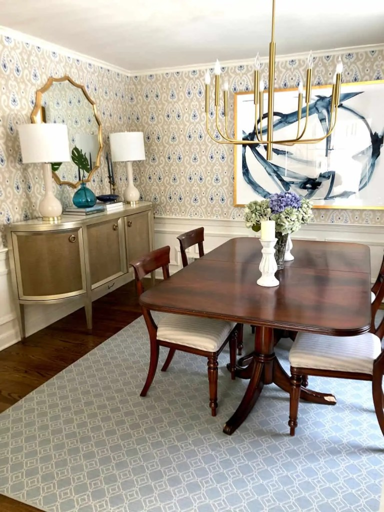 Updated Chandelier over a traditional dining Table