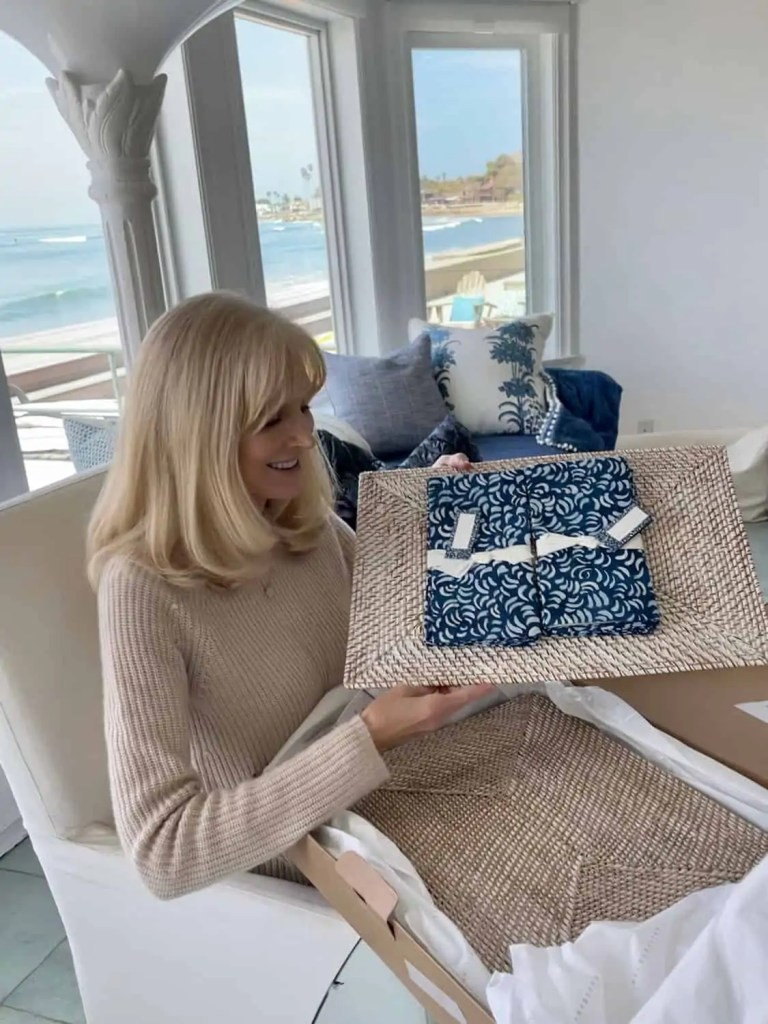 wicker placemats with blue napkins