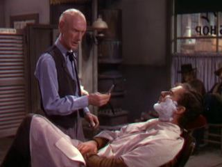 Dodge-City-1939-Errol-Flynn-and-the-Barber.jpg