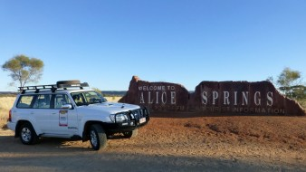Survey car parked in front of the Welcome to Alice Springs sign