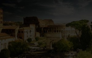 Background for the featured video, a dark overlay over the beautiful Roman Coliseum