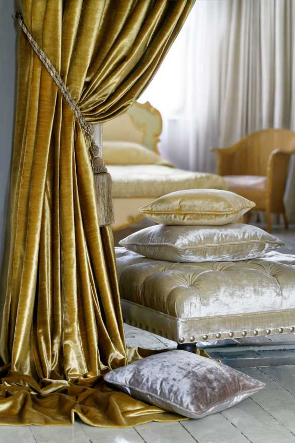"alt="" photo of gold curtains and cushions made with Clarke & Clarke Allure velvet fabric"""