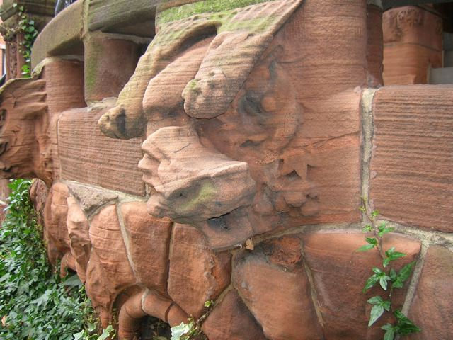 A weathered, brownstone face (formerly a dragon) from Brooklyn, NY (© David B. Williams)