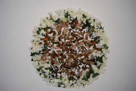 "Epitaph, 2010. Artificial and real flowers. 52"" diameter"