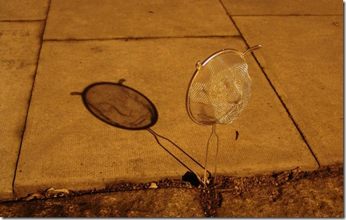 strainer-shadow-faces-made-from-colanders-isaac-cordal-4