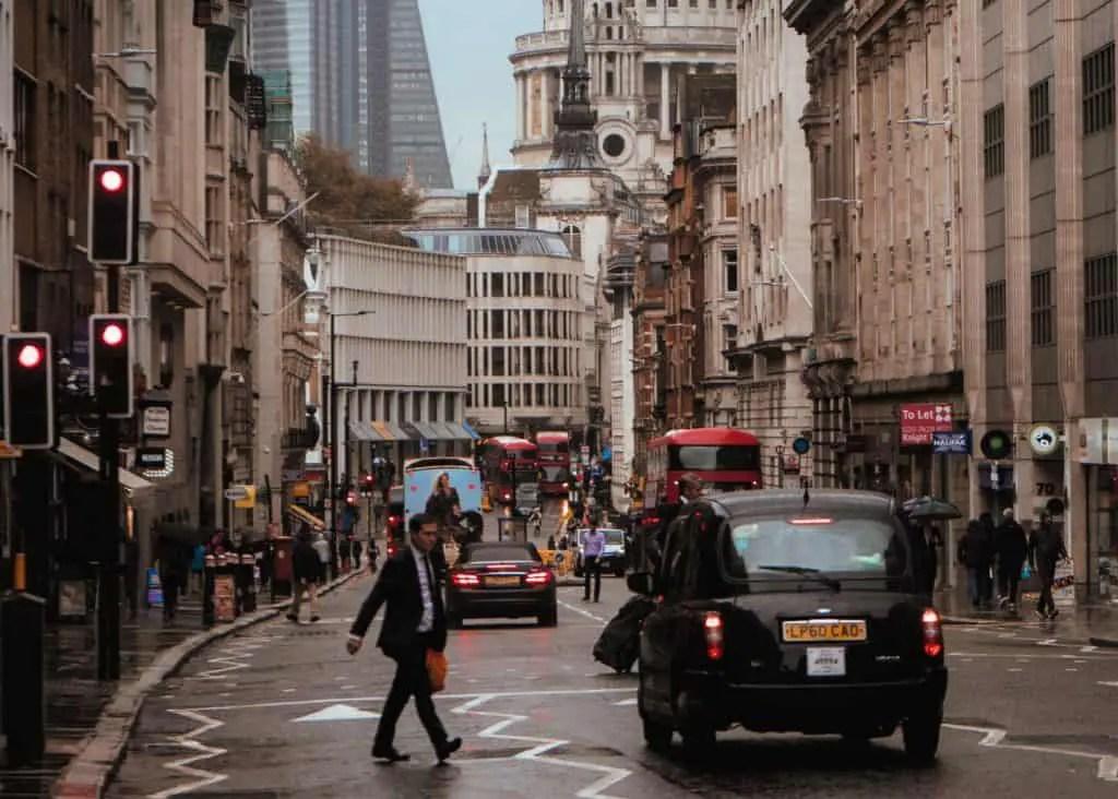 man walking across street tips for driving in europe