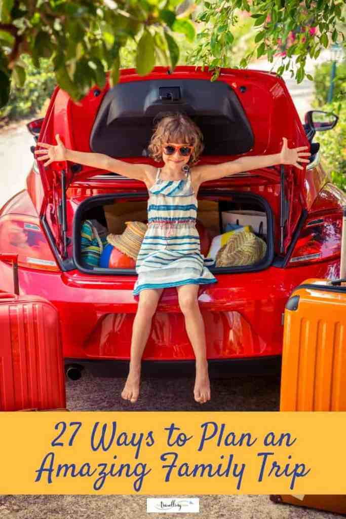 girl sitting among suitcases in car
