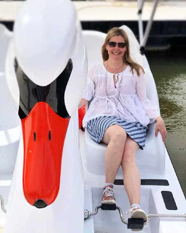 lady on swan boat in tempe