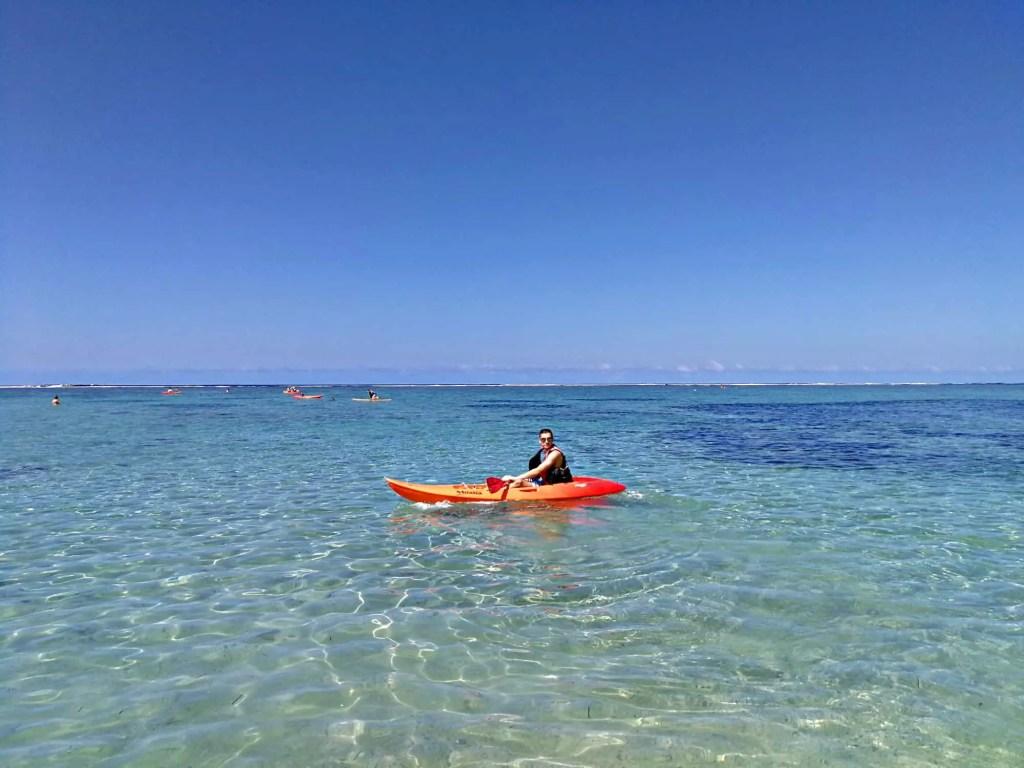 boy in kayak at outrigger fiji resort