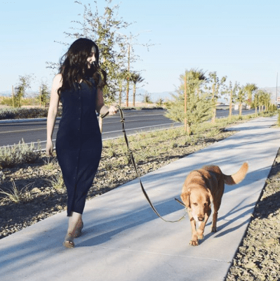 Girl taking her dog on a walk