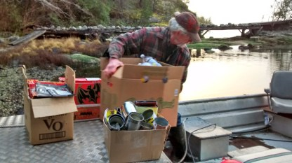Loading the recycling into the skiff...