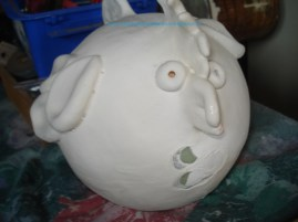 Woops i missed a spot. Although it appears white and chalky now, it comes out glossy after its second firing.