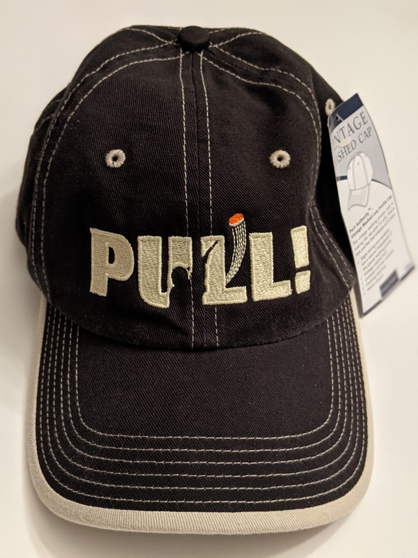 """These Port Authority brand hats feature your choice of our popular """"PULL!"""" or """"I YELL & BREAK THINGS"""" designs embroidered on the front. They are vintage """"washed"""" for a casual, lived-in look. Currently available in three sleek contrasting stitch color combinations."""