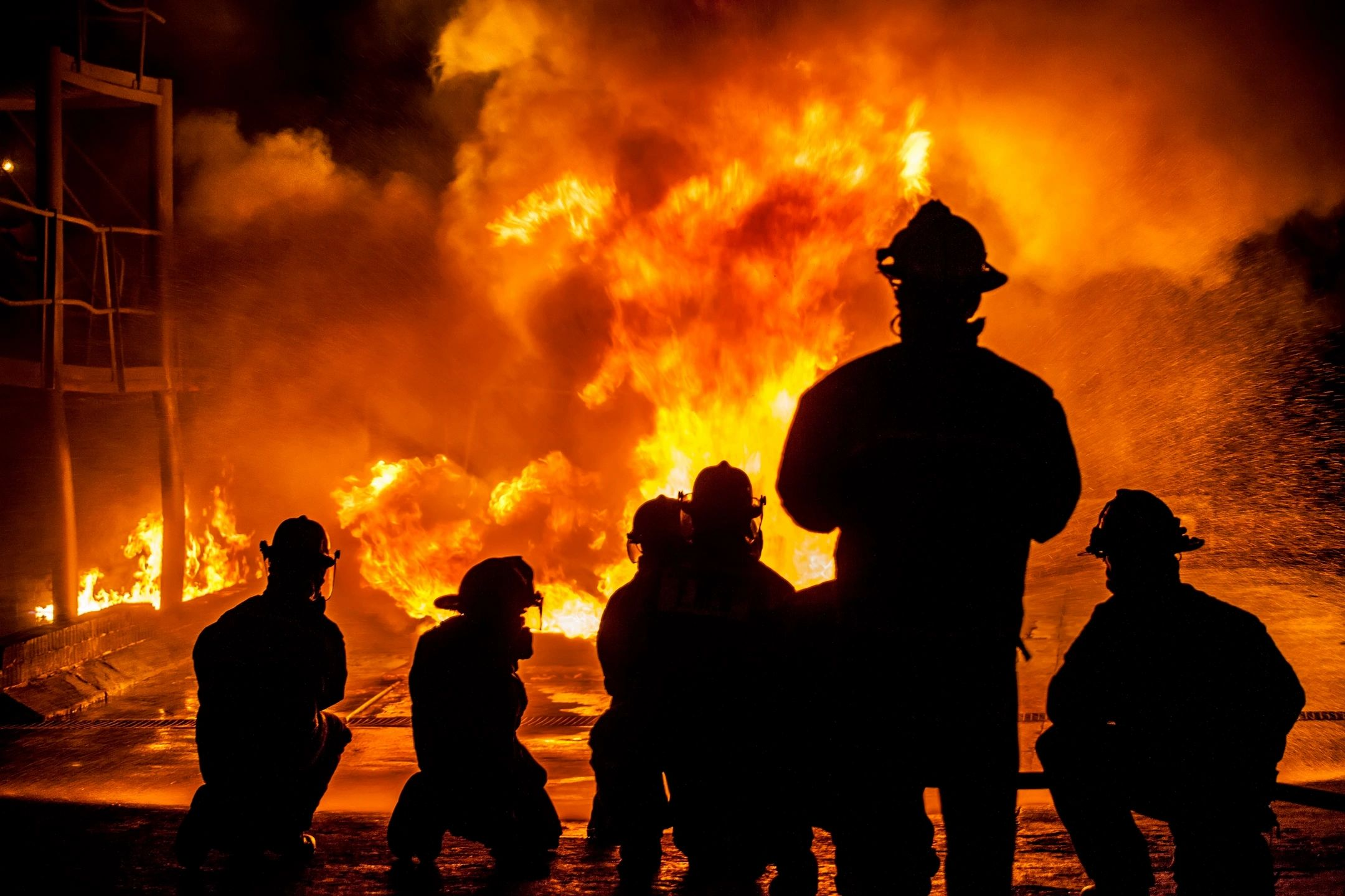 firefighters with flame backdrop