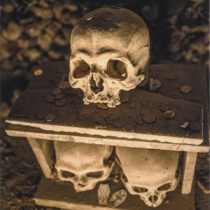 Skull on top of a guardian house kept by the anime pezzentelle cult at the Cimitero delle Fontanelle ossuary in Napoli Italy.