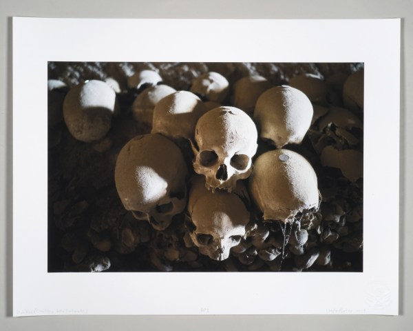 Unframed photograph printed with archival pigment ink on acid free Italian rag paper of a human skull by artist Clayton Porter.