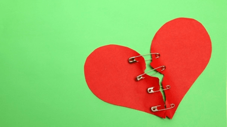 heart mended with safety pins