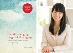 Marie Kondo and copy of her book The Life Changing Magic of Tidying Up