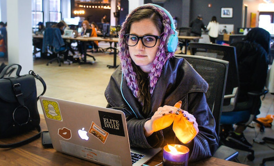 Woman trying to keep warm in cold office