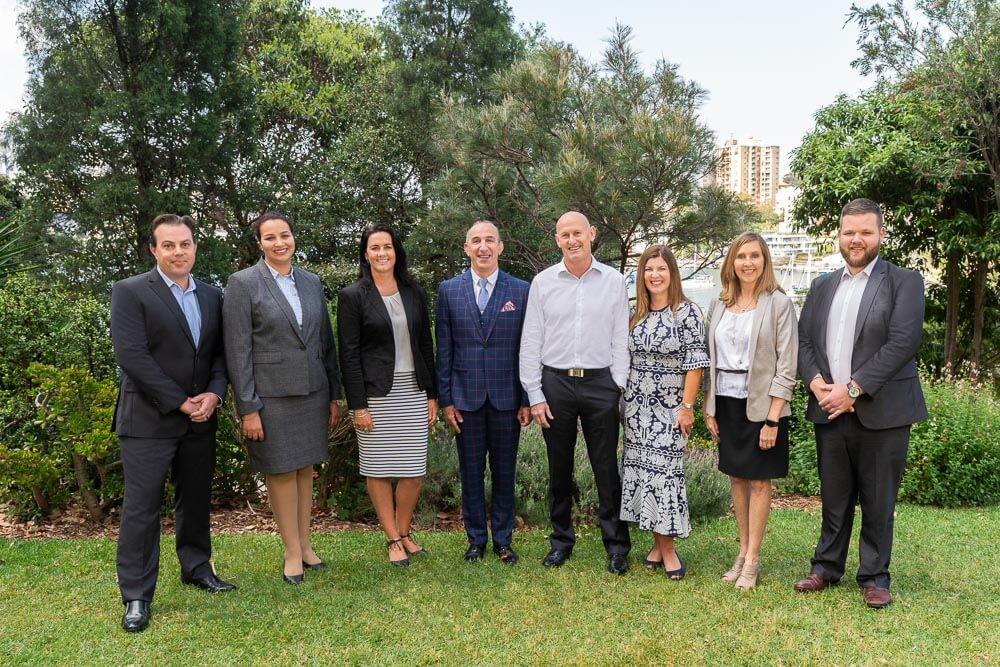 Group of Cleancorp Executive Team Members photograph in a park