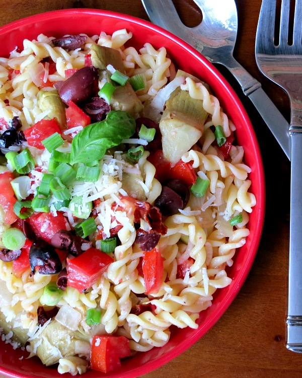 Pasta With Artichokes, Kalmata Olives, Green Onions, Tomatoes and Parmesan Cheese