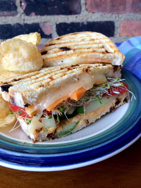 Veggie Packed Panini Sandwich with a Side of Chips
