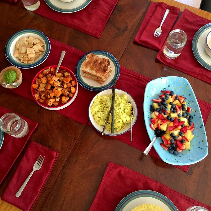 Sunday Brunch - Fruit, Pesto Scrambled Eggs, Parmesan Roasted Sweet Potatoes, and Granola Toast B