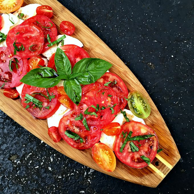 This simple summer dish combines sun-ripened tomatoes, tangy mozzarella, and fresh basil for an easy and elegant salad which comes together in mere minutes.