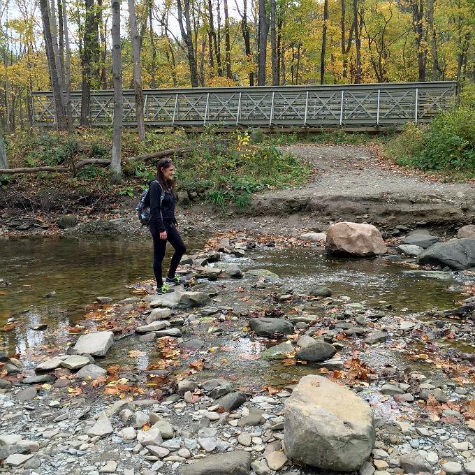 Amanda Spoons crossing the stream