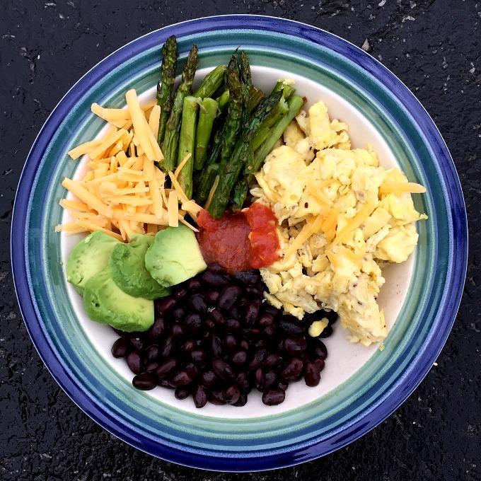 Breakfast Bowl with Scrambled Eggs, Black Beans, Asparagus, Avocado, Cheese and Salsa