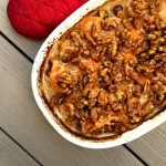 A healthy twist on a classic casserole, scalloped sweet potatoes with a bechamel sauce and candied walnuts is out of this world.