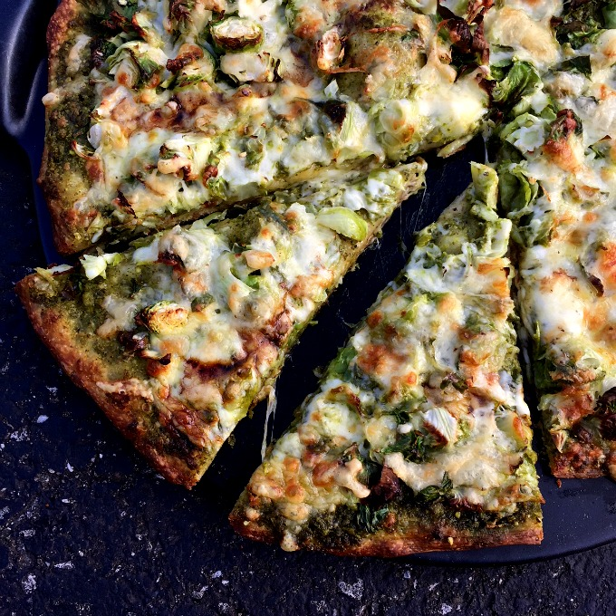 The unique combination of Brussels sprouts, pesto and a balsamic reduction truly make this pizza bold, beautiful, and bound to please, even people who don't love their veggies.
