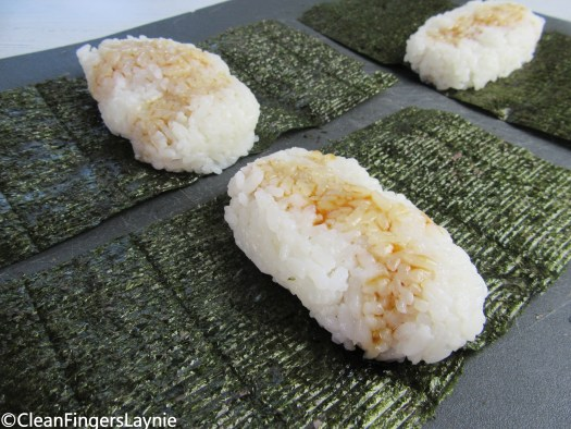 Nori and Rice Topped with Sauce Assembly for Spam Musubi Rolls
