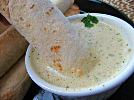 Crisp Bean Burrito Dipped in Mexican Ranch Dressing