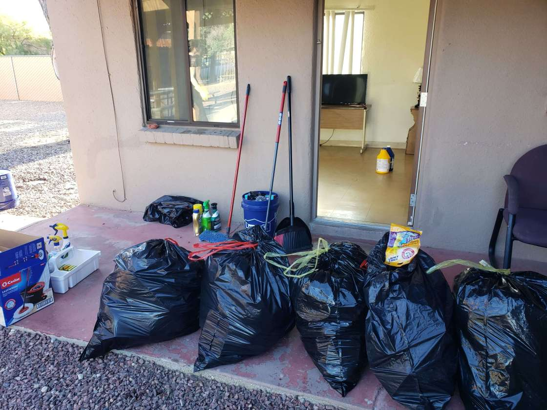 many bags of trash sitting outside an apartment after a deep clean