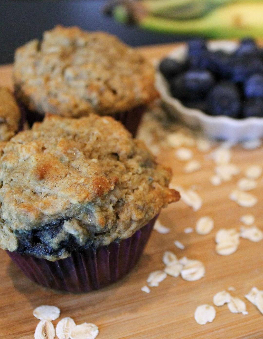 Banana Blueberry Oatmeal Muffins on wood cutting board