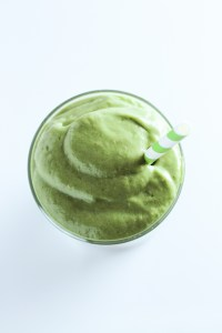 Overhead view of top of glass filled with green smoothie