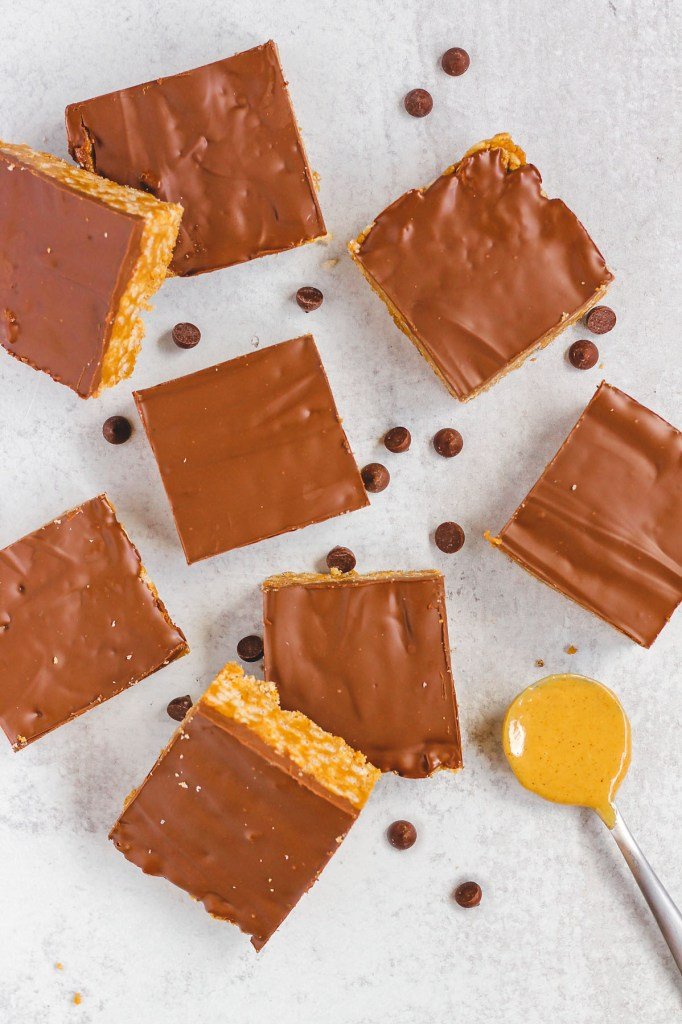 overhead view of cut up scotcheroo bars with chocolate chips sprinkled around