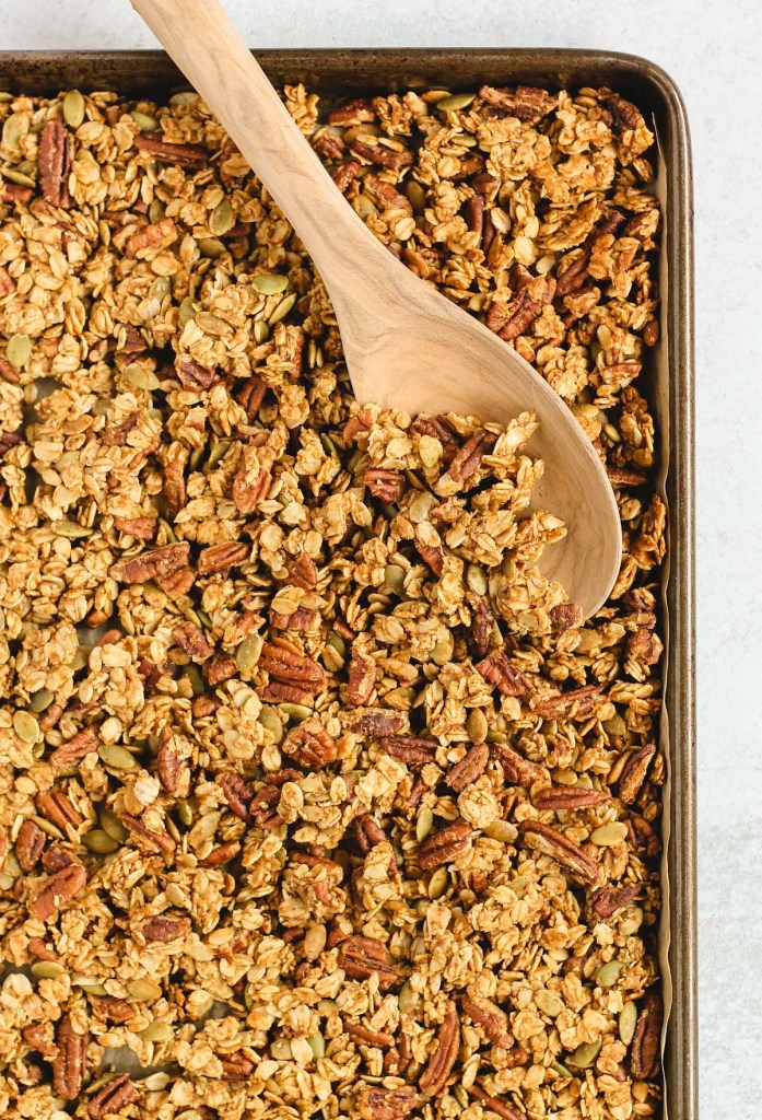 overhead view of baked granola on a baking sheet