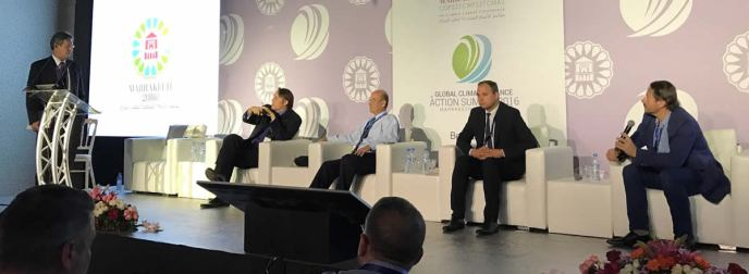 Chip Comins of the American Renewable Energy Institute leads the panel discussion on conservative tax policy with Rod Richardson (speaking) and others at COP 22.