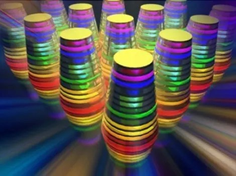 "The image shows a ""multilayered waveguide taper array."" The different wavelengths, or colors, are absorbed by the waveguide tapers (thimble-shaped structures) that together form an array. Image Credit: University at Buffalo"