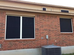 Solar screens at side of house