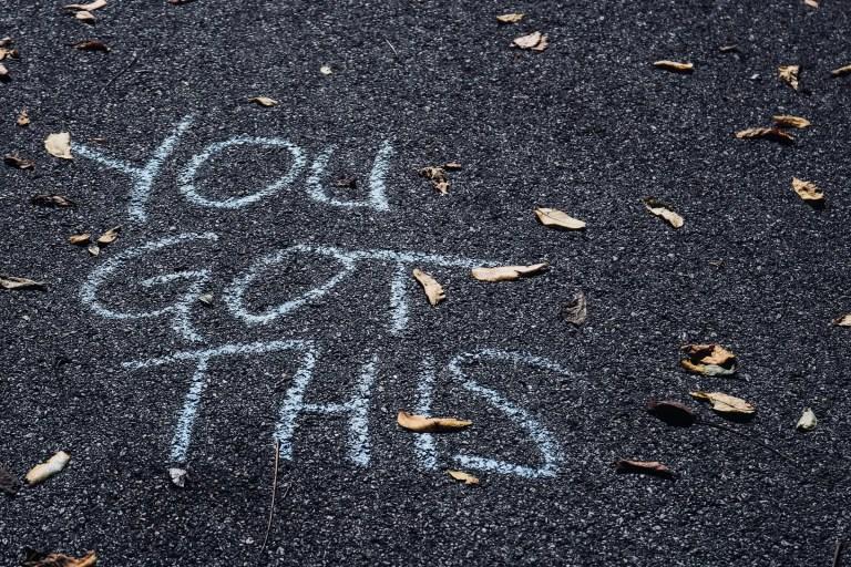 asphalt with street chalk saying you got this