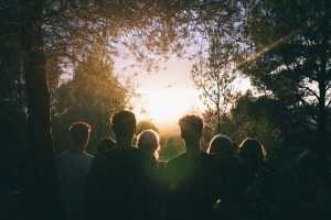 A group of people looking at the sunrise