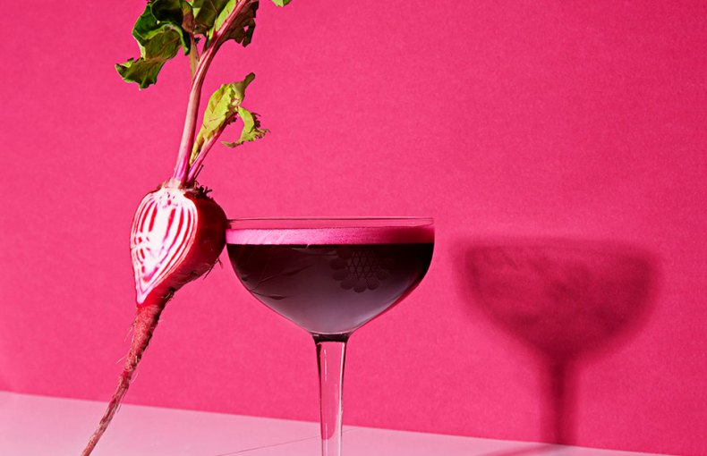 glass with beet against it