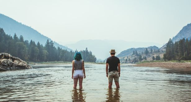 couple standing in lake