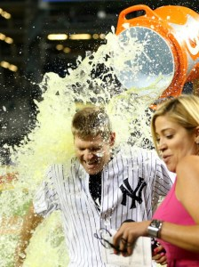 Chase getting a Gatorade bath in his first game as a Yankee after a game winning hit.