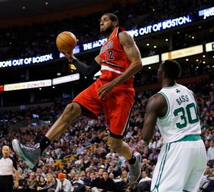 Portland Trail Blazers' LaMarcus Aldridge goes up to shoot in front of Boston Celtics' Brandon Bass (30) in the third quarter of an NBA basketball game in Boston, Friday, Nov. 30, 2012. The Celtics won 96-78. (AP Photo/Michael Dwyer)